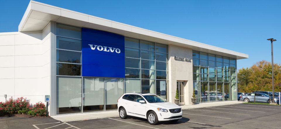 automobile dealership front exterior with glass windows
