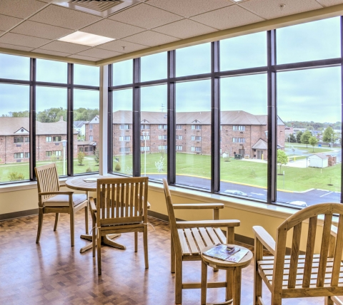 Common area with lots of windows overlooking campus at Luther Village III