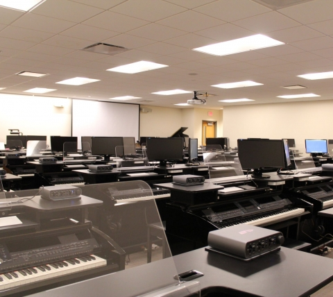 classroom of digital pianos