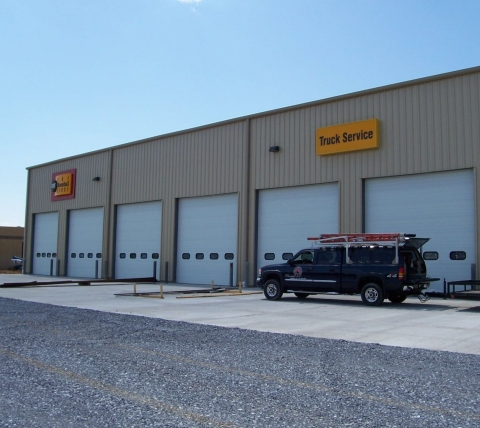 truck and equipment dealership with six garage doors