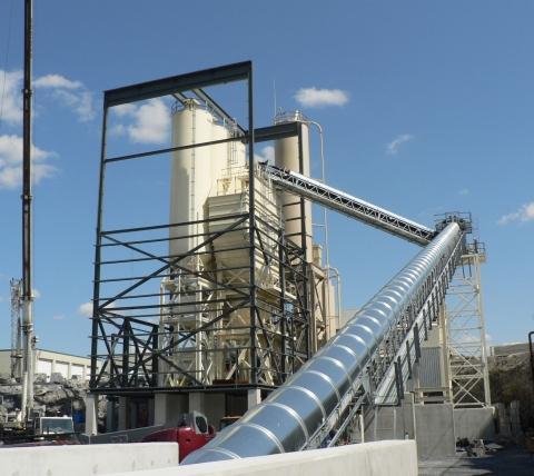conveyor tube on exterior of concrete batch plant
