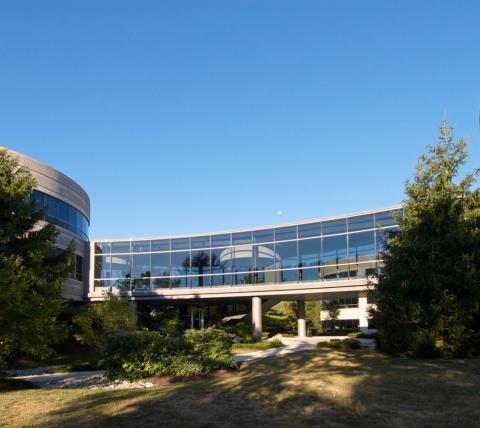 Glass pedestrian bridge between two office buildings