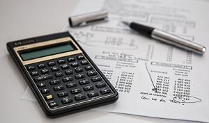 calculator spreadsheet financials pen